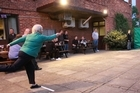 An Aunt Sally match in Banbury demonstrates the different throwing techniques. Photo / Jim Eagles