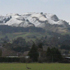 Te Mata peak with snow for first time in 40 years. Up behind Hastings. Photo / Peter Walker