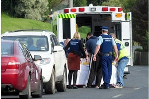 Emergency services treat a woman after a violent domestic incident in South Rd, Dunedin, last month. Photo / Craig Baxter