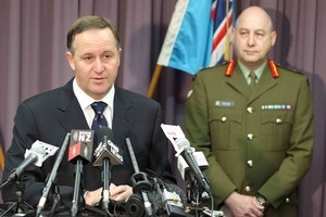 Prime Minister John Key addresses a media conference at the RNZAF Base in Whenuapai this morning, following the death of an NZSAS trooper in Afghanistan yesterday. Photo / Greg Bowker