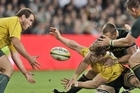 Australia's David Pocock passes the ball to teammate Ben Alexander during his team's narrow win this morning. Photo / AP