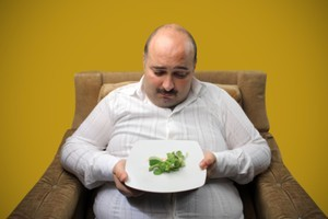 While women are more likely to put on weight after getting hitched, men tend to pack on the pounds when they are ditched. File photo / Thinkstock
