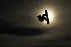 A snowboarder competes in the Big Air competition at the Winter Games. Photo / Getty Images