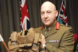 Defence Force chief Lieutenant General Rhys Jones with body armour similar to that worn by slain SAS soldier Corporal Douglas Grant. Photo / Mark Mitchell