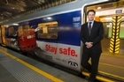 Chris Cairns alongside artwork on one of Auckland's passenger trains. Photo / Paul Estcourt