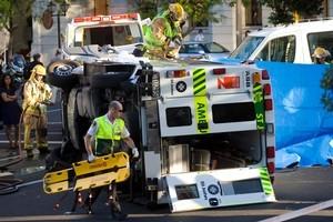 Police at the scene of a rush-hour crash involving an ambulance and an Audi. Photo / Richard Robinson
