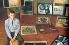 Colin McCahon  pictured with some of his work in 1971. Photo / Supplied