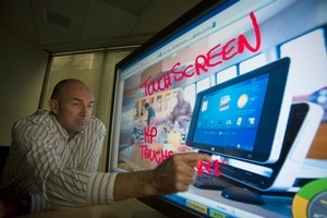 Former chief executive of NextWindow showing the company's technology. File photo / Dean Purcell