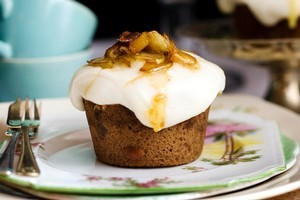 Madeira cakes with cream cheese icing and toffee pears. Photo / Babiche Martens