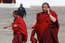 Monks on the blower at the Labrang monastery in China. Photo / Jim Eagles