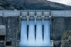 Water spilling over the Clyde Dam, part of Contact Energy's power generation portfolio. Photo / Supplied