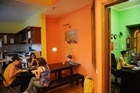 People eat in the kitchen of the Bear hostel in Moscow. The Russian city, long known for its expensive palaces and its lack of affordable hotels, is now heading for a booming youth hostel industry. Photo / AFP