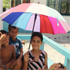 An umbrella is welcome relief from the sun for this family. Photo / Adrienne Kohler 