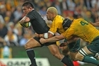 Keven Mealamu of the All Blacks is tackled by Digby Ioane and Dan Vickerman of the Wallabies. Photo / Getty Images