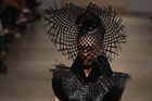 A model wears a creation by Miromoda.