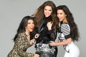 Kourtney, Khloe and Kim Kardashian with one of the handbags they will be launching in New Zealand. Photo / Supplied