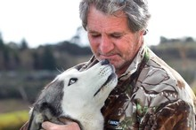 Siberian Husky Sky, and her owner Colin Andrew. Photo / Janna Dixon