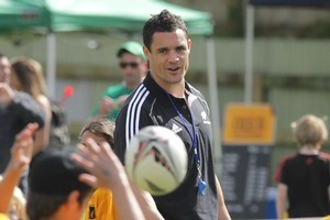 Dan Carter, Richard Kahui and Isaia Toeava spent yesterday with 3000 fans in Te Puke. Photo / Alan Gibson