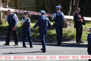 Wellington police at the scene where a woman died after being stabbed. Photo / Mark Mitchell