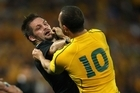 Richie McCaw jostles Quade Cooper. Photo / Getty Images
