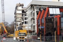 Work is continuing on demolishing buildings in central Christchurch, but do so many need to be pulled down? Photo / NZ Herald