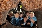 Hebron Christian College students take a look inside the lava cave uncovered by their Mt Albert school grounds. Photo / Brett Phibbs