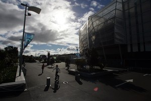 Children play outside Eden Park Rugby Stadium as it has last minute work done in the build up to the Rugby World Cup 2011. Photo / Janna Dixon