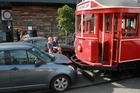 The little Suzuki was no match when a Wynyard Quarter tram reversed to let a taxi through. Photo / Stephen Hampson-Tindale