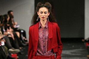 A sharp take on the tuxedo suit in burgundy was a refreshing interpretation at Andrea Moore. Photo / Babiche Martens