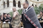 Sir Jerry Mateparae is escorted by warrior K. J. Allen during the powhiri at yesterday's swearing-in ceremony. Photo / Mark Mitchell