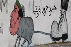 Street artists in Tripoli have nicknamed Gaddafi 'The Rat of Rats from Africa', a reference to the title he gave himself, The King of Kings. Photo / AP