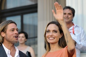 Angelina Jolie and Brad Pitt have given Shiloh an iPad to keep her entertained while they travel. Photo / AP