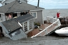 Tropical Storm Irene sent sea water flooding into shoreline communities and destroyed oceanfront homes as it surged across the United States. Photo / AP