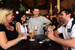 Strangers no longer, sociable souls swap stories in an Auckland pub. Photo / Janna Dixon