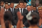 All Blacks captain Richie McCaw leads the team as traditional Maori warriors perform. Photo / Getty Images