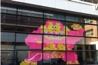 Post-it notes can be used to leave important messages, or can be used to build a giant pink gorilla. Photo / Facebook