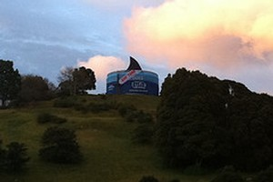 An Auckland reservoir has been turned into a giant tuna can in a campaign by Greenpeace, which claims New Zealand seafood company Sealord buys tuna caught using destructive fishing methods. Photo / supplied