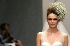 A model wears outfit from the Modes collection at the NZ Weddings show at Fashion Week 2011. Photo / Babiche Martens