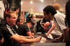 All Black halfback Andy Ellis meets student Mohammed al Mahmodi at a signing session in Auckland. Photo / Paul Harper