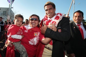 Tongan rugby captain Finau Maka poses for a photo with fans. Photo / Brett Phibbs