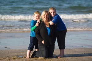 Wendy Doyle with her sons 5-year-old Harrison (left) and 8-year-old Jack on Campbells Beach. Photo / Richard Robinson
