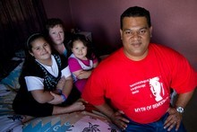 IHC sleepover worker 'Ofa Ta'ufo'ou, with his wife Sue and children Amelia, 8, and Jolene, 4, will get about $20,000 in back pay after tax. Photo / Richard Robinson