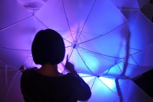 The weather installation in Myers Park includes lit umbrellas. Photo / Supplied