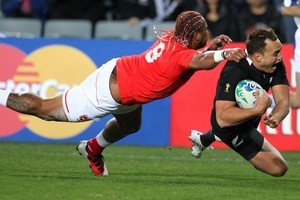 All Black fullback Israel Dagg eludes Tonga halfback Taniela Moa to score during last night's World Cup opener at Eden Park. Photo / Paul Estcourt