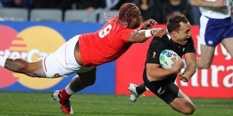 All Black fullback Israel Dagg eludes Tonga halfback Taniela Moa to score during last night's World Cup opener at Eden Park. Photo / Paul Estcourt