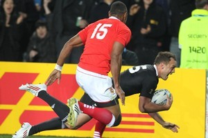 Israel Dagg scores his second try of the 2011 Rugby World Cup against Tonga. Photo / Paul Estcourt