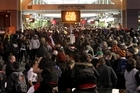 Waiting for a train ... the huge crowd outside Britomart last night as the rail system strained under the weight of numbers. Photo / Alan Gibson