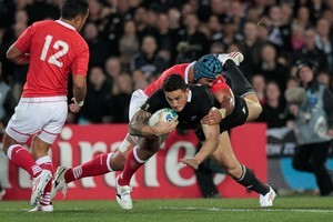All Black lock Ali Williams is airborne in the tackle against Tonga at Eden Park last night. Photo / Brett Phibbs