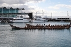 Waka glide through the waters as paddlers guide the giant canoes to a tumultuous welcome from thousands of people lining the harbourfront. There was a waka for each nation competing at the Rugby World Cup. Photo / Sarah Ivey