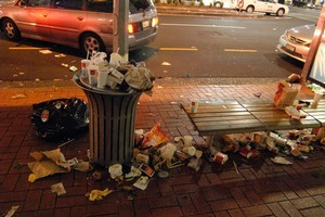 A crew of 167 are on hand to cope with the rubbish produced by World Cup partygoers in Auckland. Photo / Michael Craig